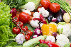 Background of fresh vegetables. Greens and tomatoes Stock Photo