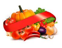 Background with fresh vegetables and red ribbon Stock Images