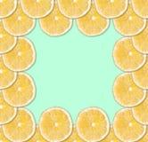 Background of fresh yellow lemon slices. Square fruit frame Close up royalty free stock image