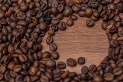 Background of fried coffee beans on a wooden surface stock photo