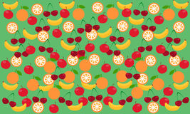 Background fruit. Green background with fruit. Banana, apple, cherry, orange Royalty Free Stock Photo