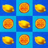 Background in fruit. Background pattern of lemons and oranges Royalty Free Stock Photo