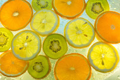 Background of fruit in water with bubbles Royalty Free Stock Images