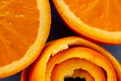 Background with fruits citrus an orange and a peel or pieces of tangerine. Macro image stock photos