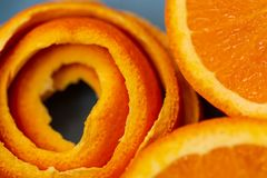 Background with fruits citrus an orange and a peel or pieces of tangerine. Macro image stock photo