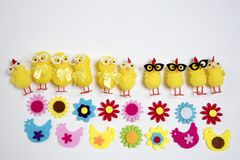 The background with funny figures of chickens and flowers from felt. Easter card Stock Photography