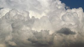 Game of clouds. Background with a game of clouds against a blue sky stock footage
