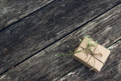 Background with gift box and flower on wood grunge boards. Stock Photos