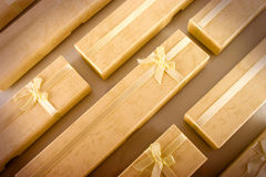 Background of gift boxes. Background of yellow gift boxes stock photography