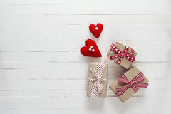 Background with gift boxes and hearts on white painted wooden pl Royalty Free Stock Images