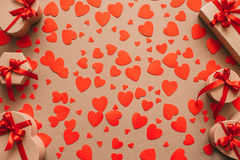 Background of gift boxes and red hearts. Stock Images