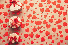 Background of gift boxes and red hearts. Royalty Free Stock Photo