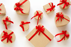 Background of gift boxes and red hearts. Stock Photo