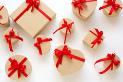 Background of gift boxes and red hearts. Stock Image