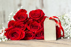 Background of gift paper and red roses Stock Photo