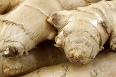 Background of ginger root Stock Photos