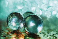 Glass ball green blue color blur background luxury gold light textured bokeh reflection. Background glass ball green blue color reflection Royalty Free Stock Photos