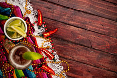 Background: Glass of Mexican Beer and Limes for Cinco De Mayo Royalty Free Stock Photo