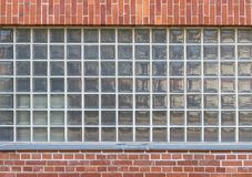 Background with glass stones. And red bricks Royalty Free Stock Photography