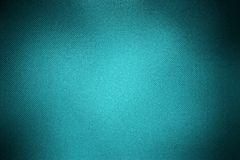 Background glass textile. Glassy (glass) or textile textured grunge abstract aquamarine (blue) background (pattern, backdrop) with dark vignette (frame, border Stock Photo