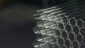 A background of glass tubes with the refraction of light stock video