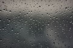Grey metallic background. Background on glass window after rain Royalty Free Stock Images