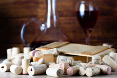 Background with glass of wine, decanter and corks. Background with glass of wine, decanter and wine corks. Wine concept Royalty Free Stock Photography