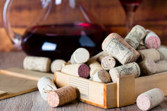 Background with glass of wine, decanter and corks. Background with glass of wine, decanter and wine corks. Wine concept Royalty Free Stock Photo