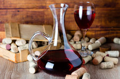 Background with glass of wine, decanter and corks. Background with glass of wine, decanter and wine corks. Wine concept Stock Photography