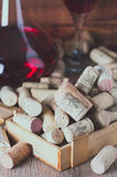 Background with glass of wine, decanter and wine corks. Wine concept Stock Image