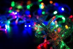 Background with glowing Christmas garland Stock Photos