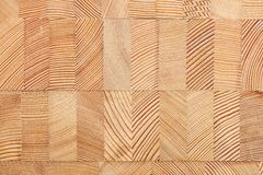 Background with glued larch wooden blocks. Stock Image