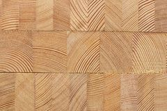 Background with glued larch wooden blocks. Royalty Free Stock Photography