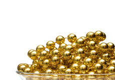 Background with gold beads Royalty Free Stock Photography