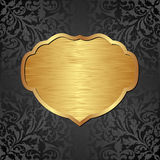 Background. Gold and black background with ornaments and frame Stock Images