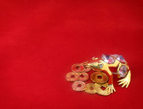 Background with gold frog protecting coins Royalty Free Stock Photography