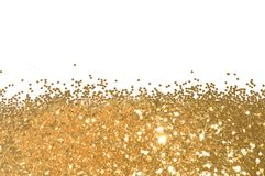 Background with gold glitter sparkle on white, decorative spangles. In nostalgic colors royalty free stock photos