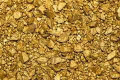 Background of gold nuggets Royalty Free Stock Photos
