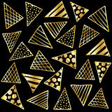 Background gold triangles on black Stock Image