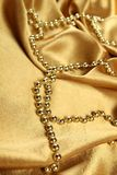 Background of golden fabric Royalty Free Stock Photo