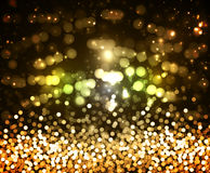 Background of the golden glitter and glare Stock Photo