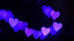 Heart bokeh. Background from golden hearts bokeh stock video