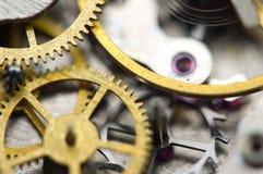 Background with golden metal cogwheels inside clockwork. Conceptual photo for your successful business design. Macro Stock Photo