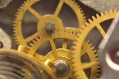 Background with golden metal cogwheels inside clockwork. Royalty Free Stock Images