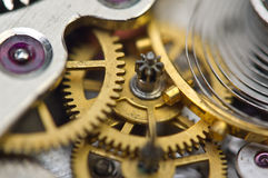 Background with golden metal cogwheels inside clockwork. Conceptual photo for your successful business design. Macro Royalty Free Stock Photo