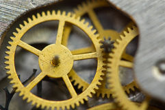 Background with golden metal cogwheels inside clockwork Stock Photos