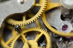 Background with golden metal cogwheels inside clockwork. Conceptual photo for your successful business design. Macro Royalty Free Stock Image