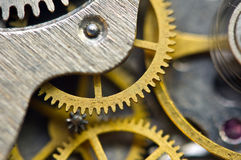 Background with golden metal cogwheels inside clockwork. Macro. Background with golden metal cogwheels inside clockwork. Conceptual photo for your successful Royalty Free Stock Image