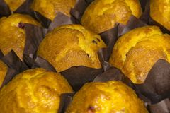 Muffins in brown wrapping paper on the counter royalty free stock photo