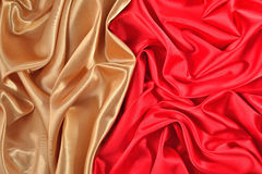 Background from golden and  red satin fabric Stock Images